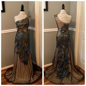 JOVANI PEACOCK JEWELED ONE SHOULDER BALL GOWN